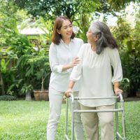 old-elderly-asian-woman-uses-walker-walking-backyard-with-her-daughter_41689-1494